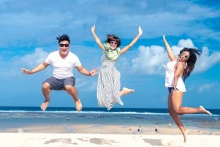 People having fun at the beach using their personal loan cash